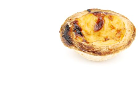 close-up of a delicious pastel de nata, typical pasty from Lisbon - Portugal (isolated on white background) photo