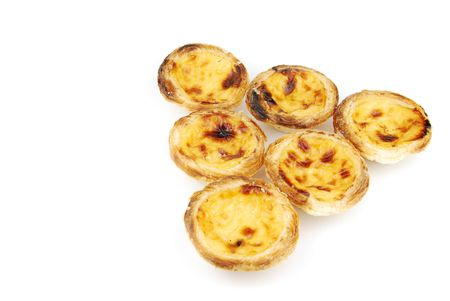 pyramid of delicious pasteis de nata, typical pasty from Lisbon - Portugal (isolated on white background) photo