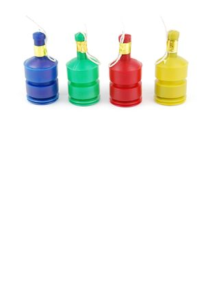 colorful party poppers isolated on white background photo