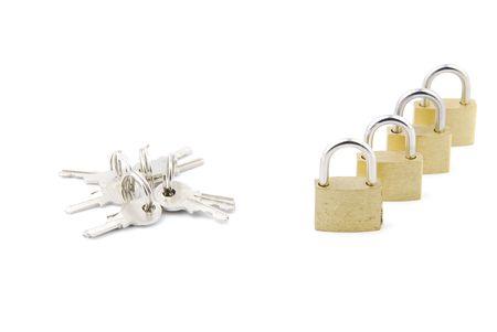 closed golden padlocks with keys isolated on white background Stock Photo - 6380919