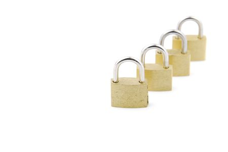 golden closed padlocks isolated on white background (focus on the first) photo