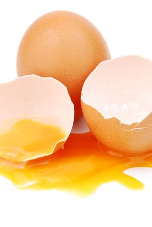 broken egg with the yolk and white oozing out isolated on white background Stock Photo - 6380996