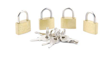 golden closed padlocks with keys isolated on white background Stock Photo - 6380936