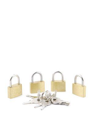 golden closed padlocks with keys isolated on white background Stock Photo - 6380909