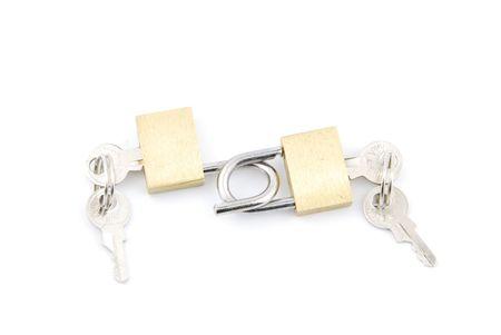 two golden padlocks and keys on white background Stock Photo - 6380924