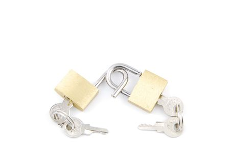 two golden padlocks and keys on white background