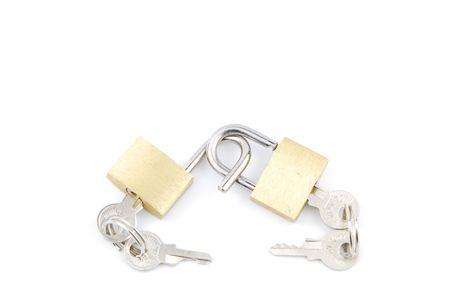 two golden padlocks and keys on white background  photo
