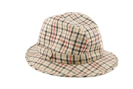 checked brown hat isolated on white background  photo