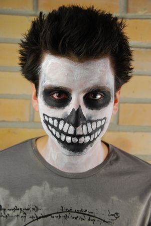 portrait of a creepy skeleton guy perfect for Carnival (brick wall background) Stock Photo - 6449672