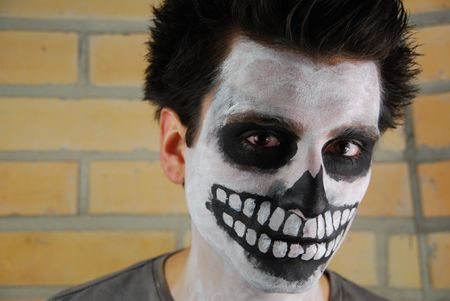 portrait of a creepy skeleton guy perfect for Carnival (brick wall background) Stock Photo - 6449670