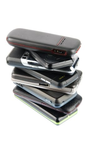 pile of several mobile phones isolated on white background