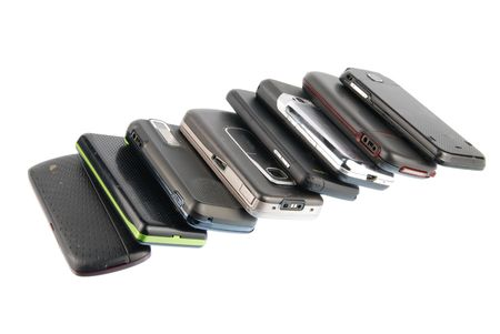 row of several mobile phones isolated on white background Stock Photo