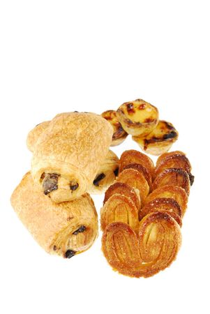 nata: nice assortment of pastries (pastel de nata, pain au chocolat and palmier) isolated on white background