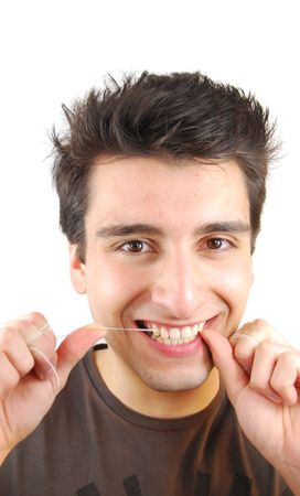 young man flossing his teeth isolated on white background