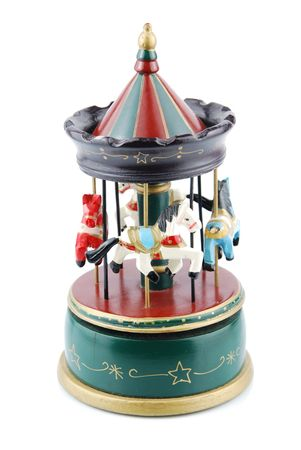 oyuncak: beautiful wooden antique carousel toy with animals (isolated on white background) Stok Fotoğraf