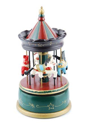 juguetes antiguos: juguete de hermoso carrusel antiguo de madera con animales (aislado sobre fondo blanco)  Foto de archivo