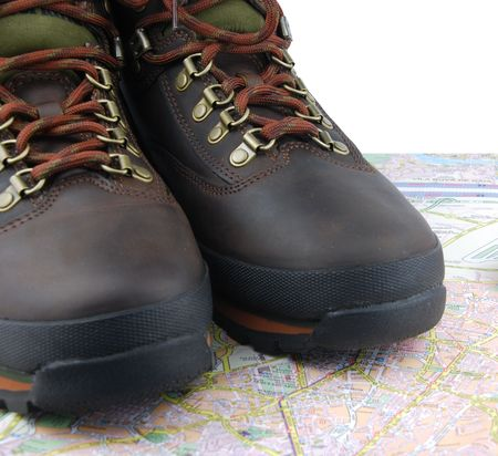 leather hiking boots and map as a travelorientation concept photo