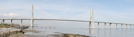 panoramic view of the longest bridge in Europe known as Vasco da Gama (over the Tagus river) photo