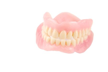 full set of acrylic denture isolated on white background