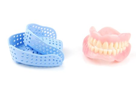 acrylic denture and acrylic trays isolated on white background photo