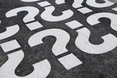 question mark signs painted on a asphalt road surface photo