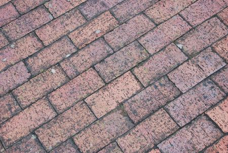 diagonal and grungy brick tile pavement surface photo