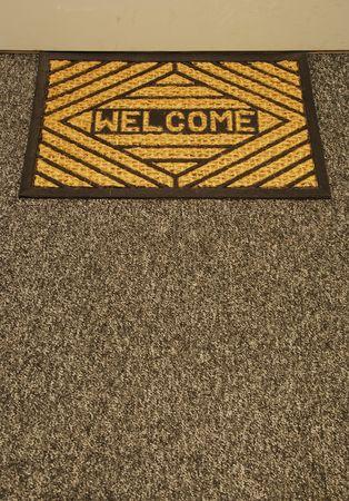 wipe: beautiful welcome home door mat on a grey carpet Stock Photo