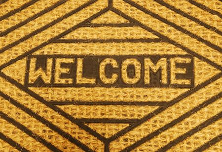 close-up on a beautiful welcome home door mat photo