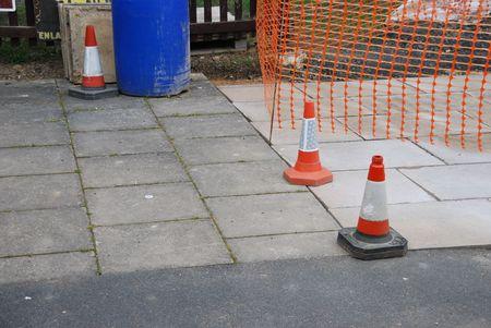 delimitation: sidewalk construction site with orange cones and delimitation area