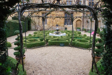 topiary knot garden and fountain at Sudeley Castle in Winchcombe, Gloucestershire (United Kingdom)