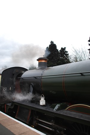 beautiful and old antique steam train on the railway photo