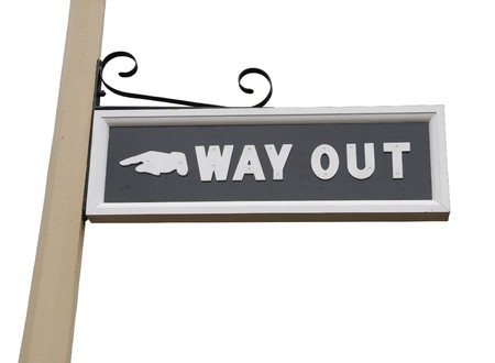 way out: vintage way out sign on wooden post (isolated on white background)