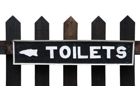 vintage toilets sign on wooden fence (isolated on white background) photo