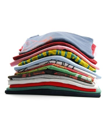 gray clothing: pile of colorful t-shirts isolated on white background Stock Photo
