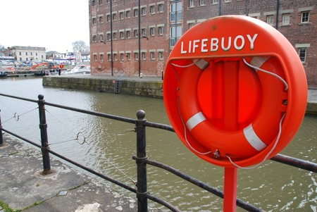 orange buoy foam lifesaving ring at Gloucester docks in England, UK Stock Photo - 7198390