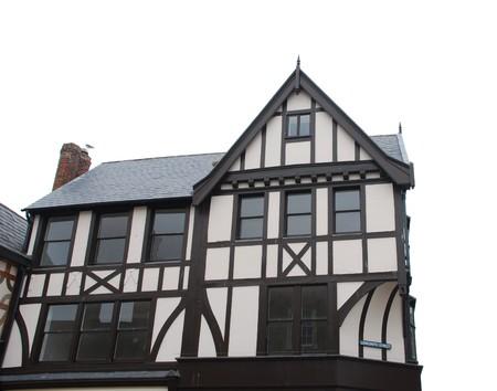 beautiful black and white tudor house isolated on white background in Gloucester, England UK photo