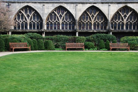 exterior garden with benchs inside the famous Gloucester Cathedral, England (United Kingdom)