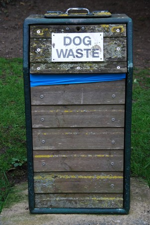 wooden bin for dog waste at the park photo
