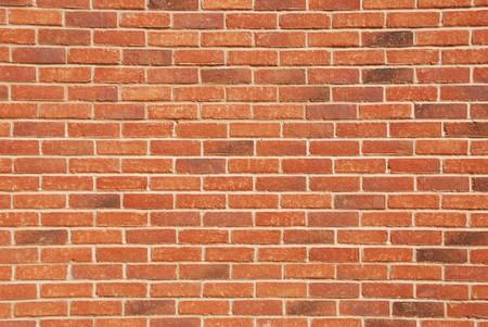 paredes exteriores: fondo o la textura de un muro de ladrillo  Foto de archivo