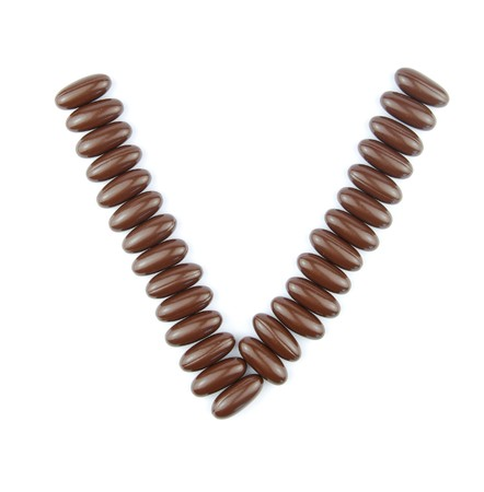 alphabet letter V with chocolate candies (isolated on white background) Stock Photo - 7195579