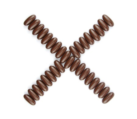 alphabet letter X with chocolate candies (isolated on white background) Stock Photo - 7195581