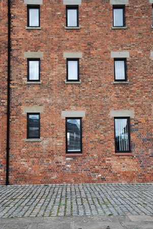 antique brick wall building with windows (british architecure in Gloucester, England, UK) photo