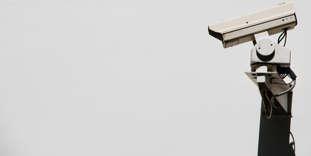 video surveillance camera on a wall Stock Photo