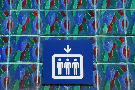 ascensor: blue and white elevator sign on portuguese azulejostiles