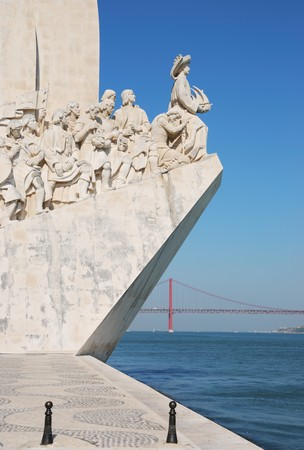 discoverer: famous monument to the maritime discoveries in Lisbon, Portugal (April 25th bridge on the background) Editorial