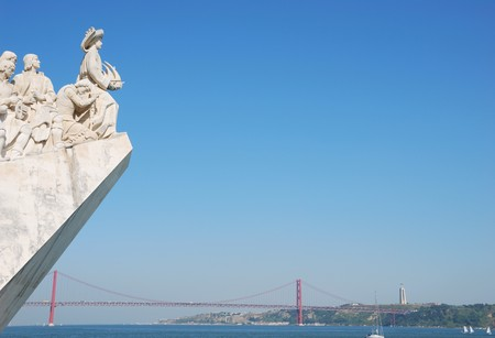 famous monument to the maritime discoveries in Lisbon, Portugal (April 25th bridge on the background)
