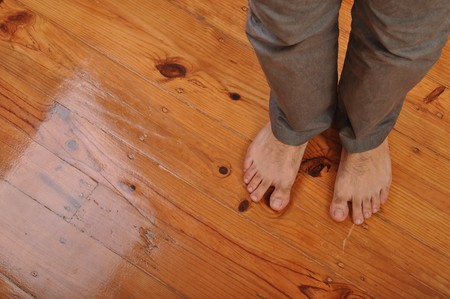 bare foot: young man bare feet on wooden floor background