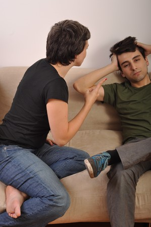 angry sister arguing with his younger grown-up brother (lessons from older people) photo