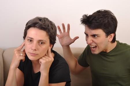angry brother yelling at her older sister Stock Photo