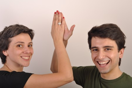happiness between sister and brother giving each other high five photo